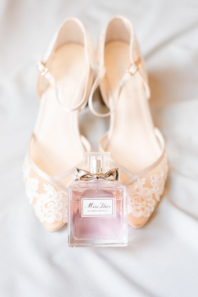 shoes and perfume for the bride photographed by Renee Nicolo Photography