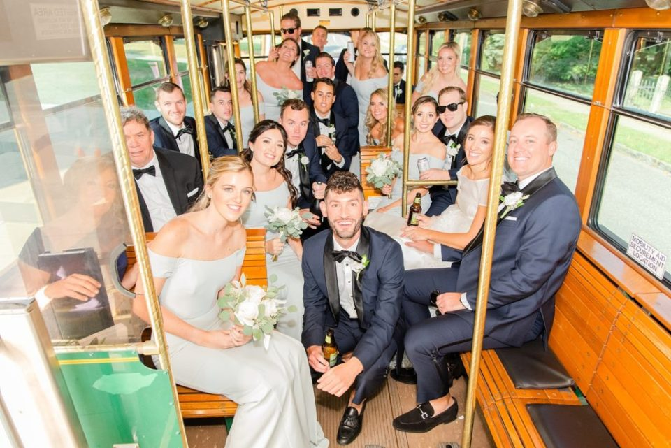 bridal party on trolley photographed by Renee Nicolo Photography