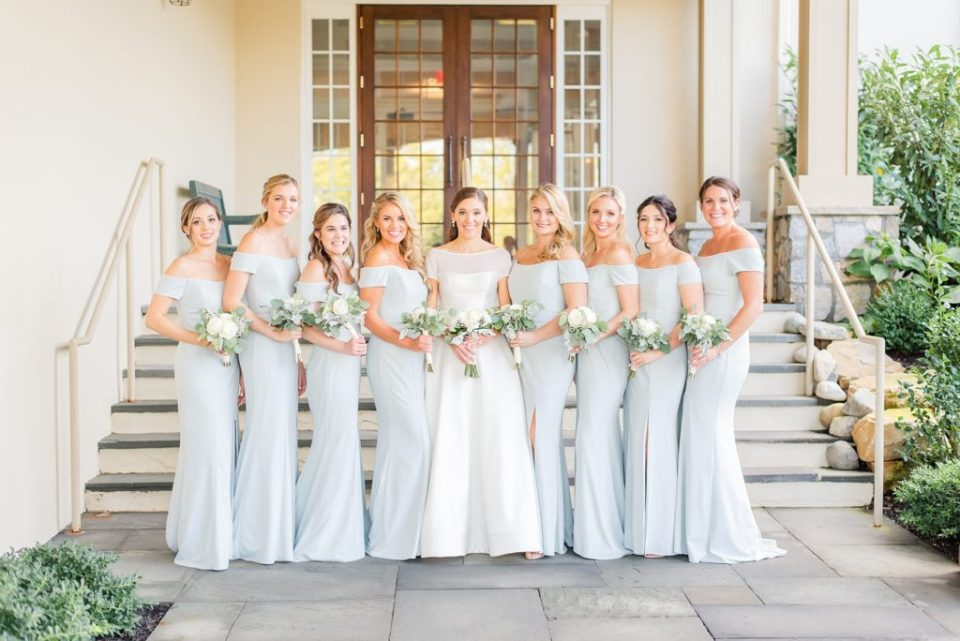bridesmaids and bride outside Whitemarsh Valley Country Club photographed by Renee Nicolo Photography