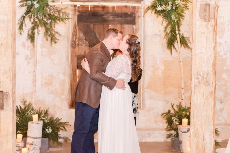 first kiss during wedding ceremony photographed by Renee Nicolo Photography