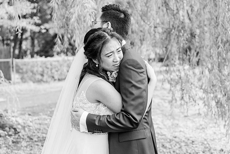 emotional first look before NJ backyard wedding