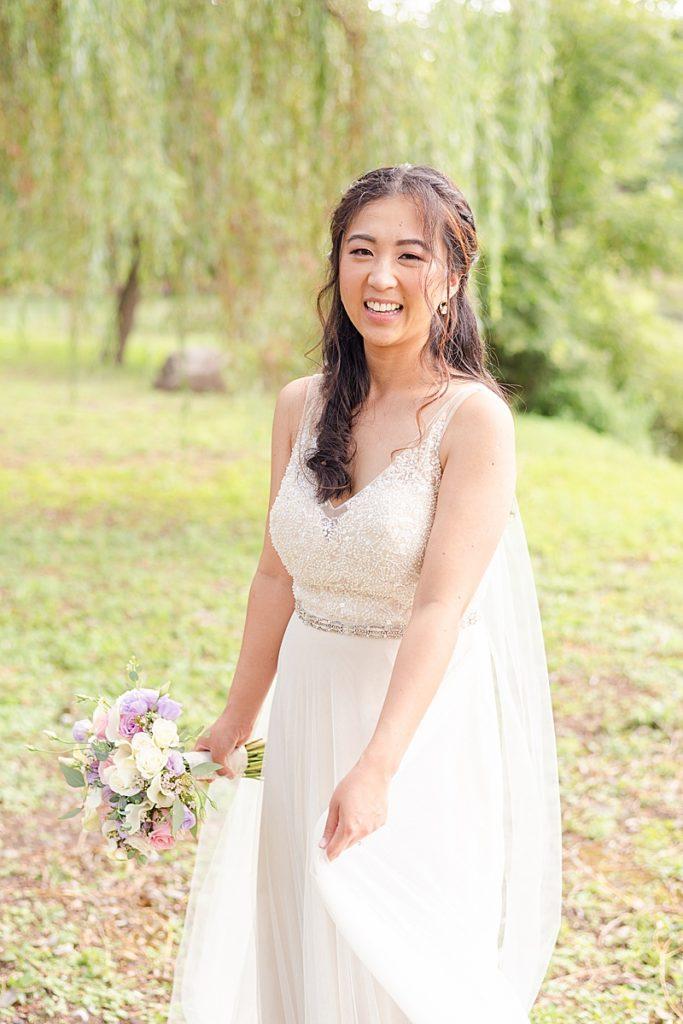 bride twirls wedding gown