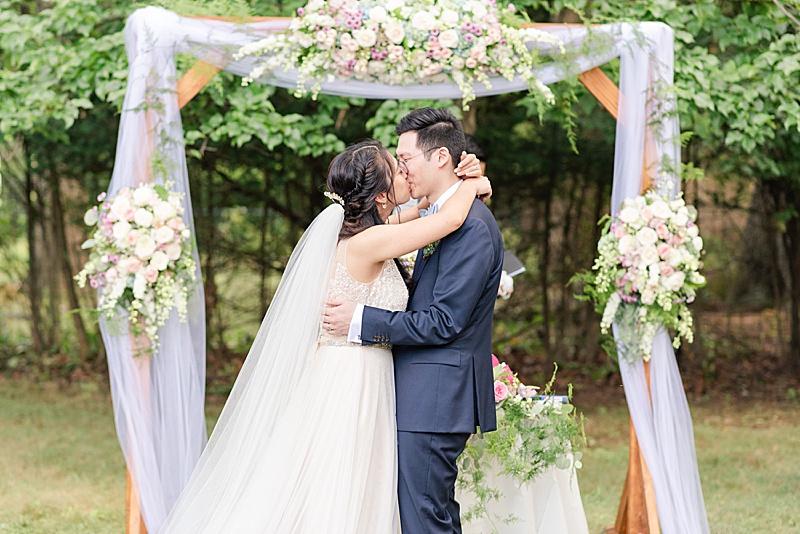 first kiss at NJ backyard wedding ceremony