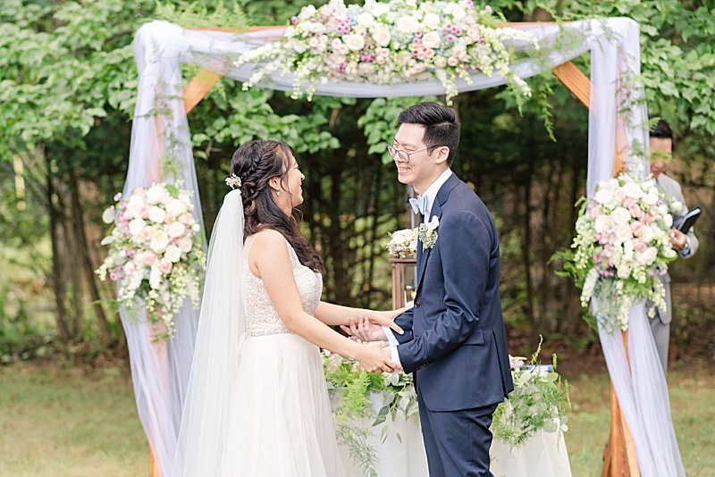 bride and groom laugh after ceremony in backyard
