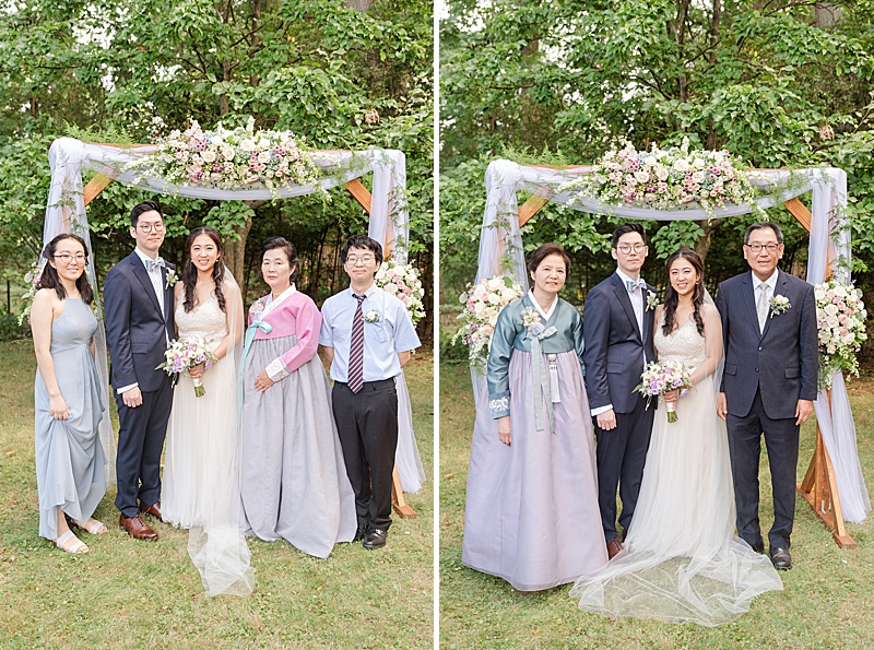 bride and groom pose with families in New Jersey
