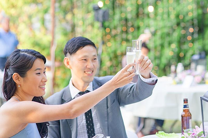 guests raise glass for NJ backyard wedding reception