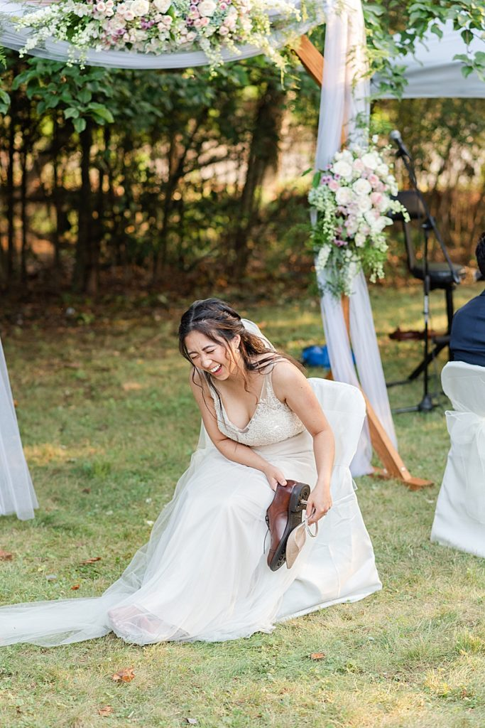 bride laughs during shoe game