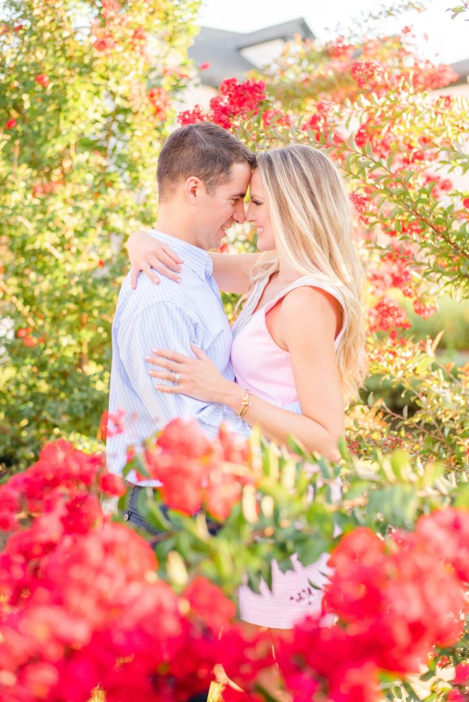 engagement photos in New Hope Garden with pink flowers