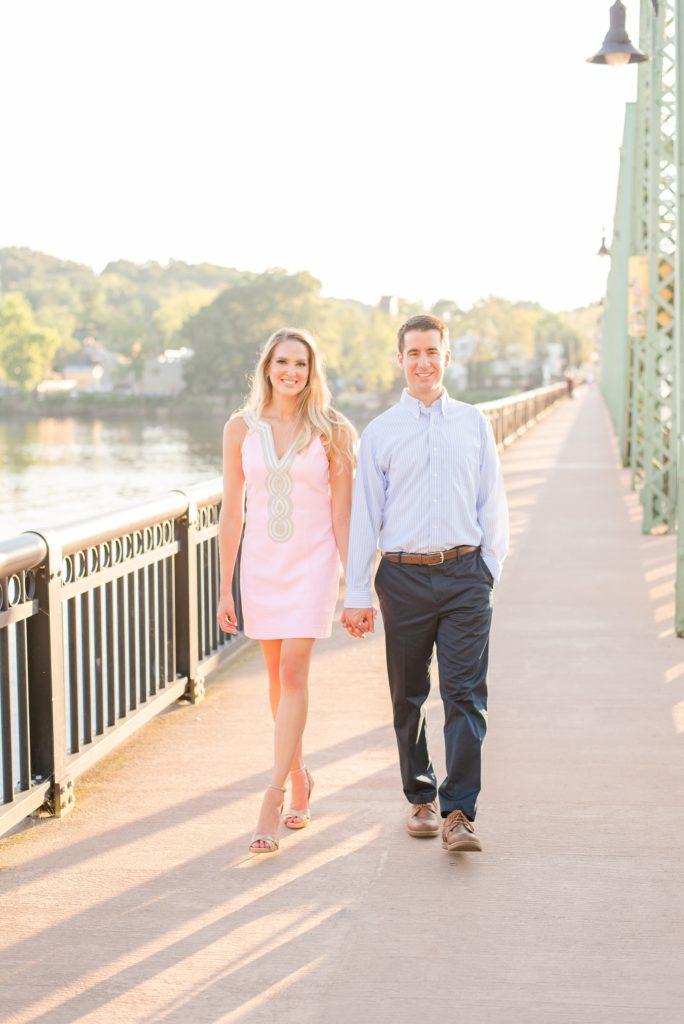 New Hope Engagement Session with couple walking on bridge