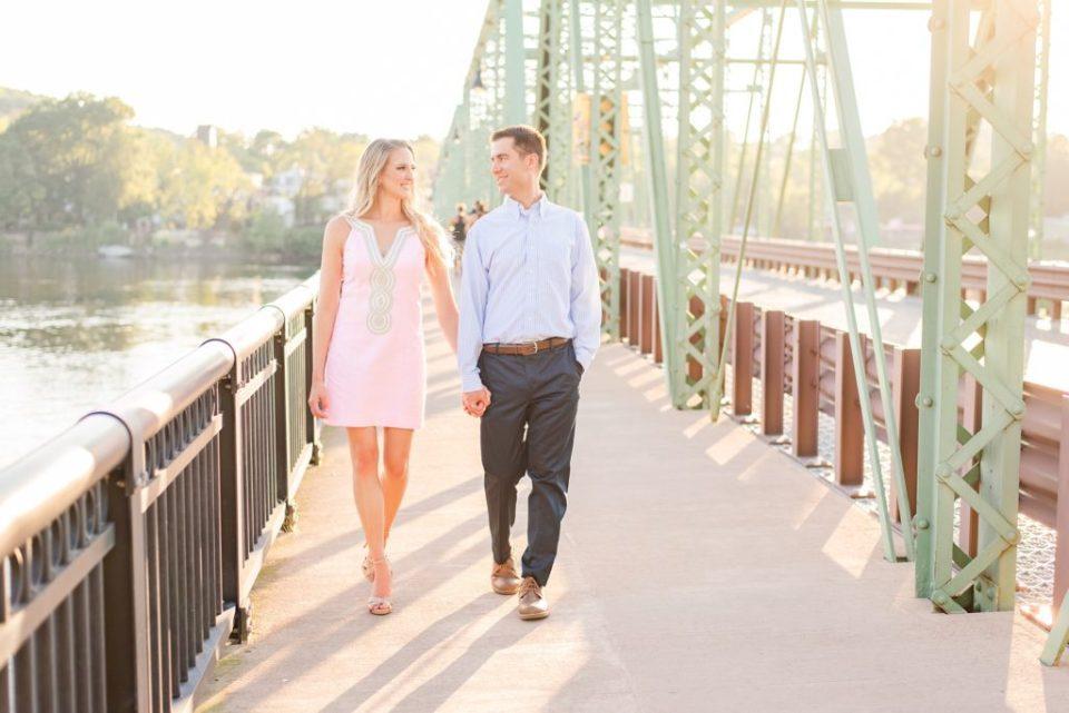 couple walks along bridge in New Hope