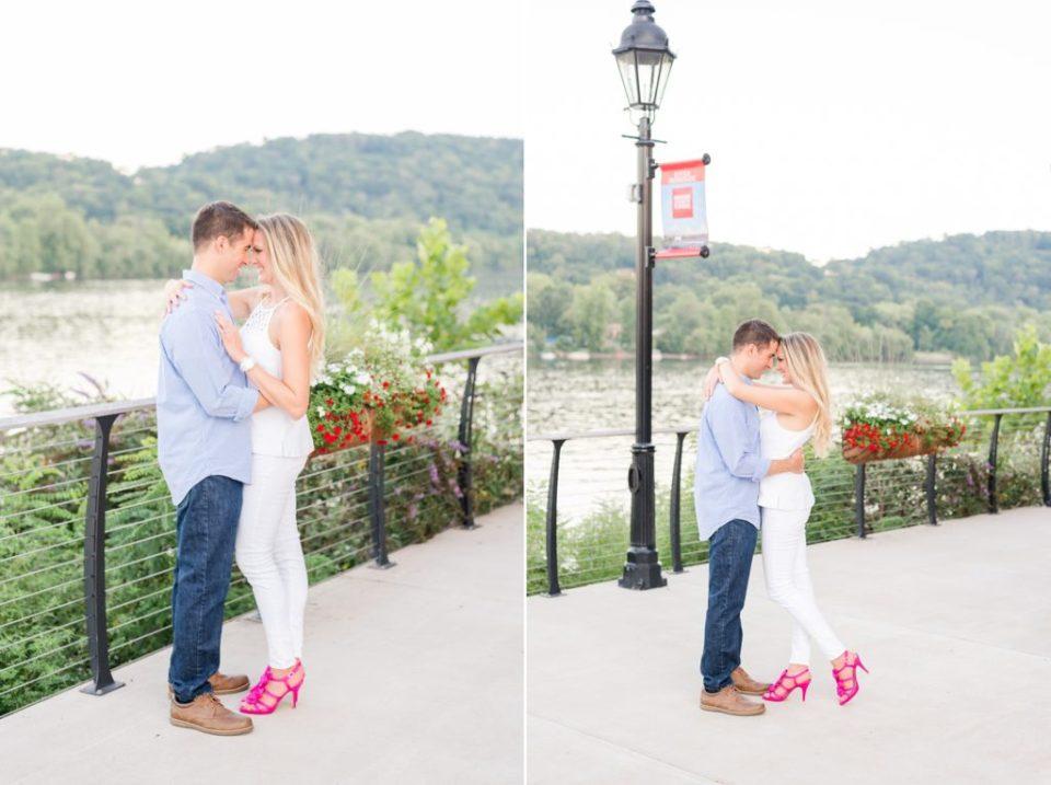 engaged couple poses on New Hope PA bridge