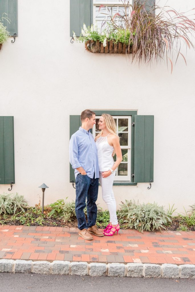 engaged couple poses by New Hope PA homes