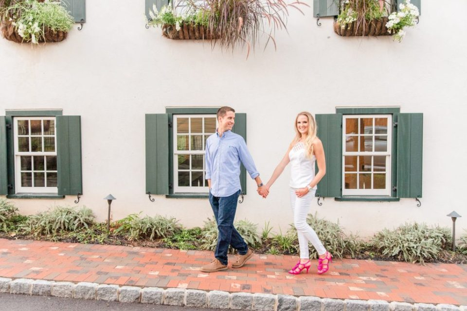 couple walks along sidewalk in New Hope