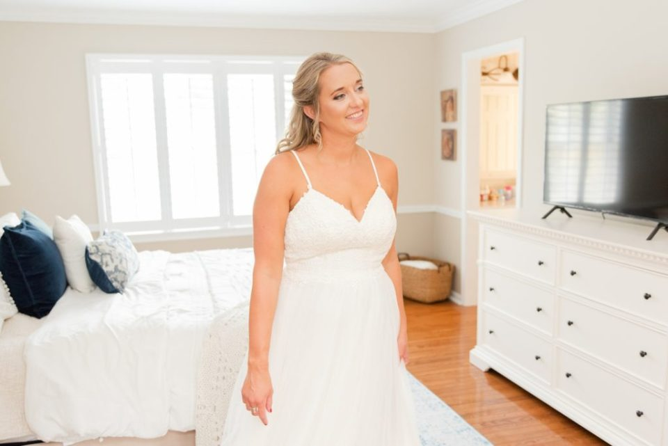 bride looks at dad during first look
