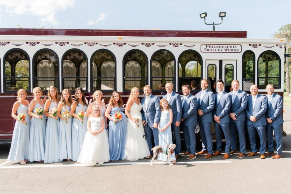 bridal party poses by Philadelphia Trolley
