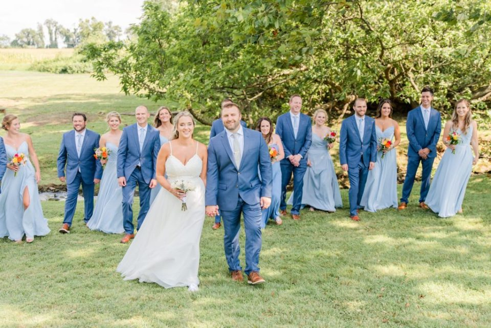 bride and groom walk with bridal party in PA