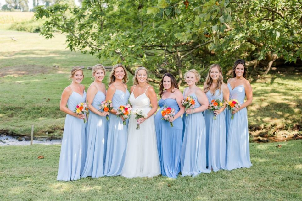 bridesmaids in blue gowns pose at Graeme Park