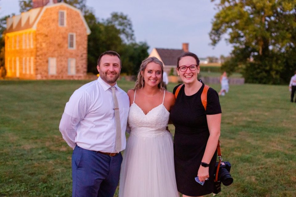 Renee Nicolo Photography poses with newlyweds at Graeme Park wedding reception
