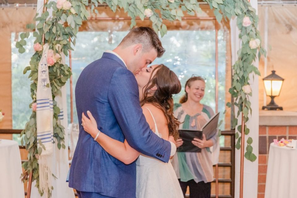 bride and groom kiss after wedding ceremony in PA