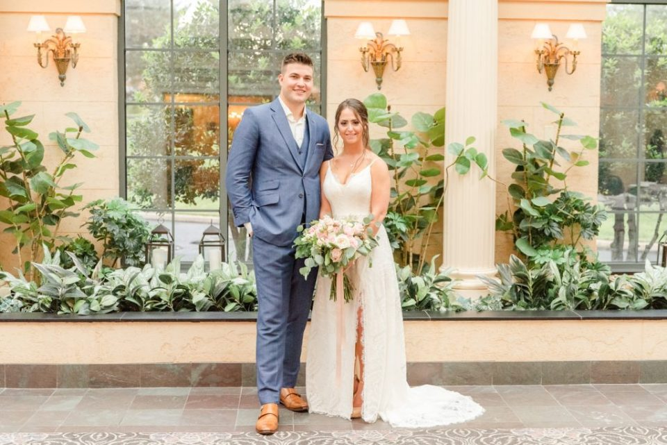 bride and groom look forward during wedding portraits in hotel