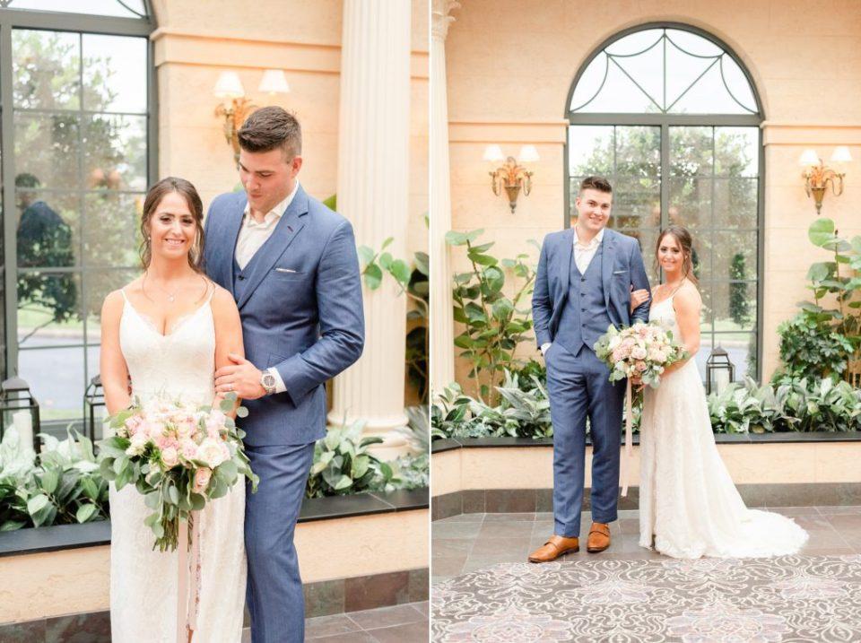 groom in navy suit holds bride