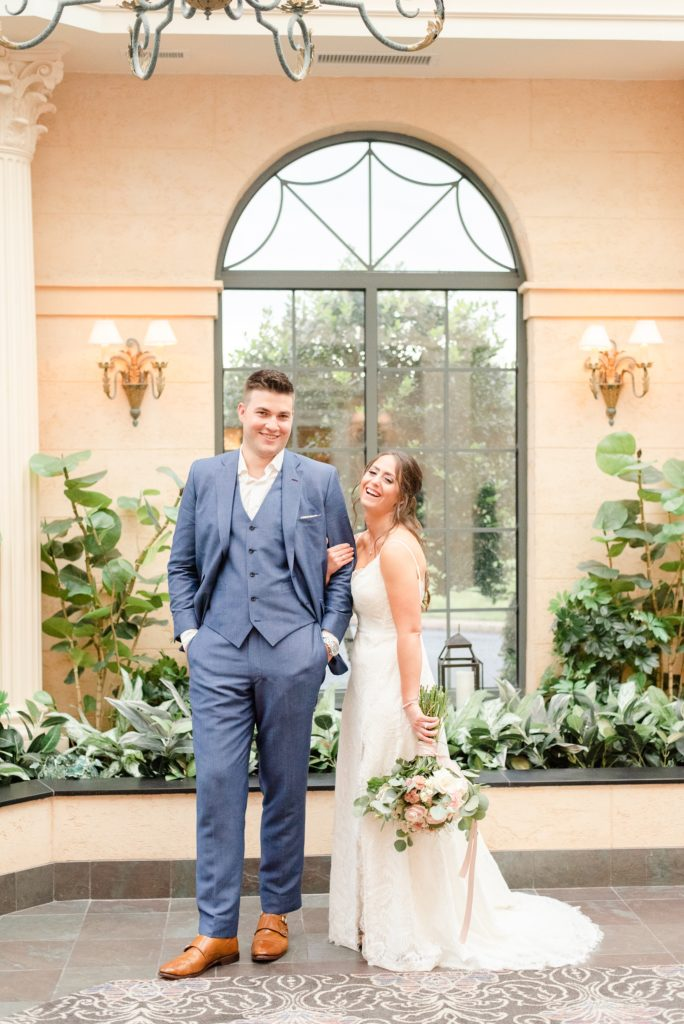 bride laughs during wedding photos at the Desmond Hotel
