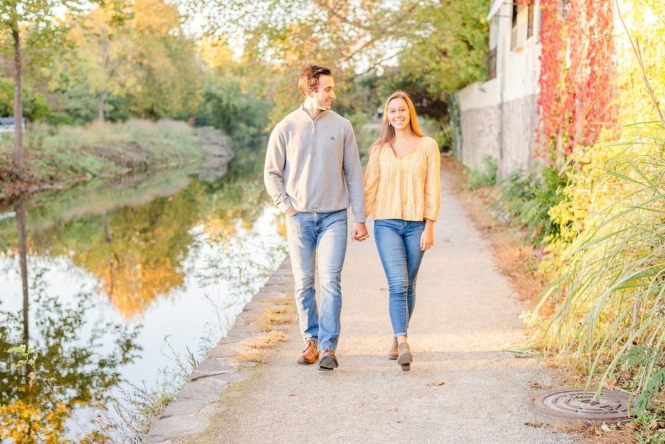 bride and groom walk along canal in New Hope PA