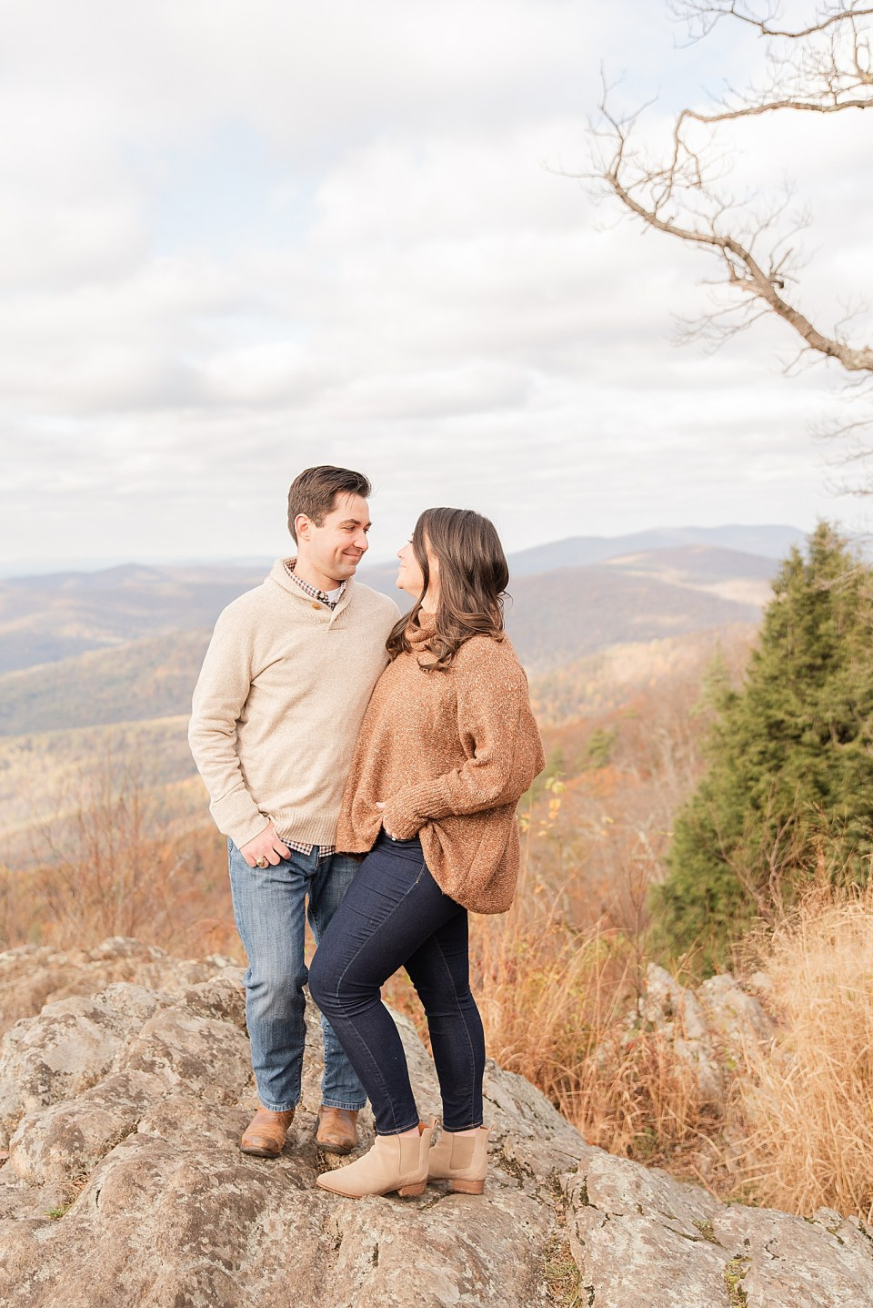engaged couple stands together on rocks at Shenandoah National Park