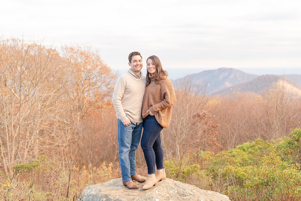 couple poses on rock during Shenandoah National Park engagement photos