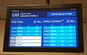 delta air line gids display for first class and comfort plus upgrade screen atlanta atl airport renespoints blog