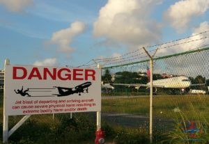 danger jets taking off sign sxm maho beach renespoints blog