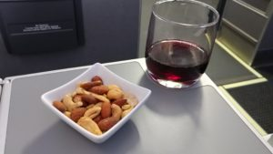 Hot nuts and wine on AA 1st class flight RenesPoints blog