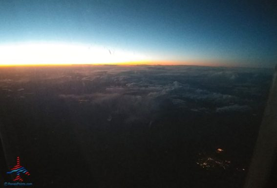 sunset from a delta jet clouds renespoints