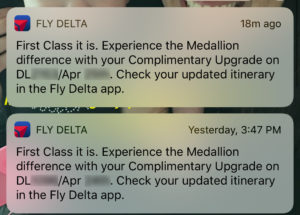 Fly Delta notifications alerting a passenger to first class upgrades, as seen on an iPhone home screen.