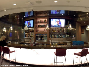 The bar and liquor bottles are seen at the Delta Sky Club Austin airport lounge at Austin-Bergstrom International Airport (AUS) in Austin, Texas. Photo © Chris Carley / PointsLounge