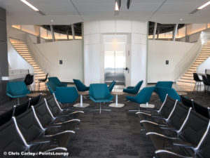 Two staircases and an elevator lead to the Delta Sky Club Austin airport lounge at Austin-Bergstrom International Airport (AUS) in Austin, Texas. Photo © Chris Carley / PointsLounge