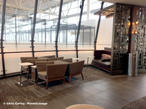 A seating area inside the circular bar portion is seen at the Delta Sky Club Austin airport lounge at Austin-Bergstrom International Airport (AUS) in Austin, Texas. Photo © Chris Carley / PointsLounge