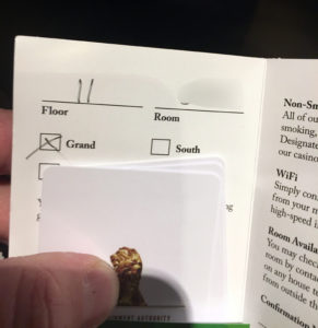 An MGM Grand Hotel & Casino key card packet with room number and tower location.