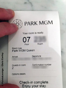 A Park MGM check-in receipt with room number, stay dates, and confirmation number.