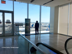 A guest looks at airplanes during a visit to the United Club at LAX airport lounge.