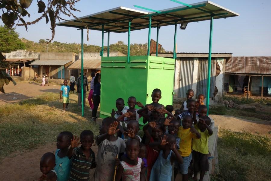 Children waving in the fishing village of Got Kachola.