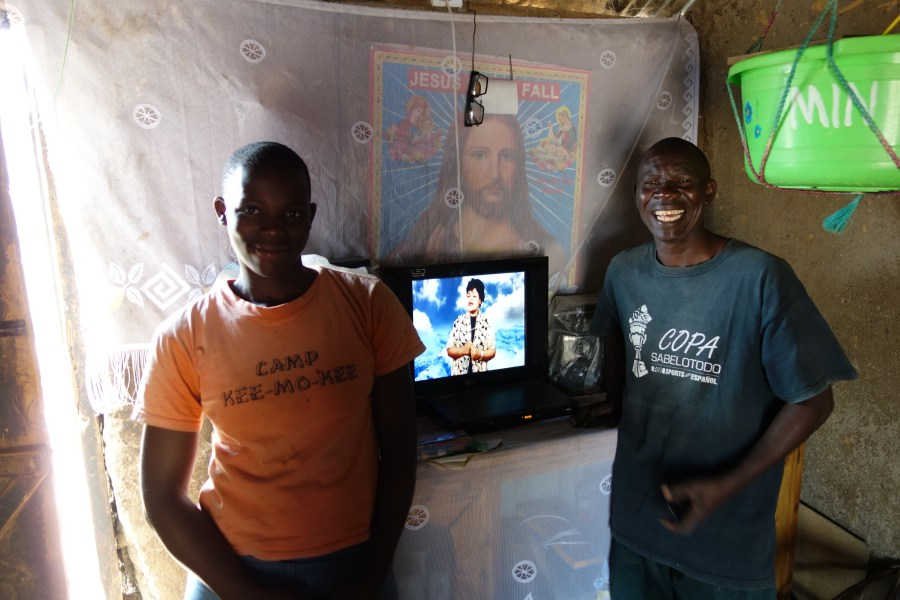 Charles with a television powered by the community energy hub.