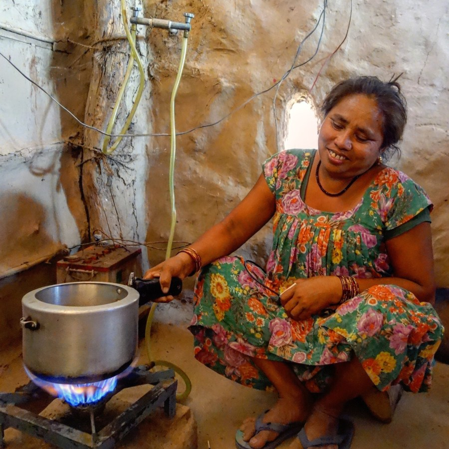 a woman using one of the renewable technologies - biogas