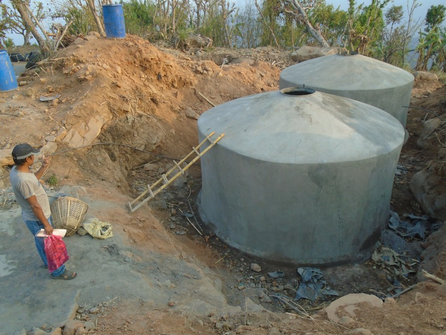 View of two large concrete water storage tanks under construction