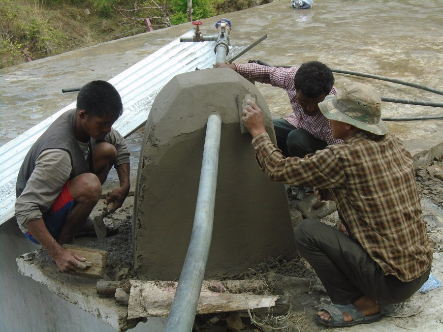 Community members begin to install piping for the solar-powered pump