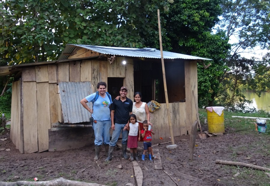 A family and the blueEnergy technicians with their newly installed solar energy system