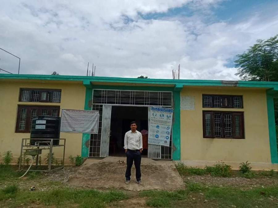 Bhuwan Poudel stands in front of Chepang Health Post