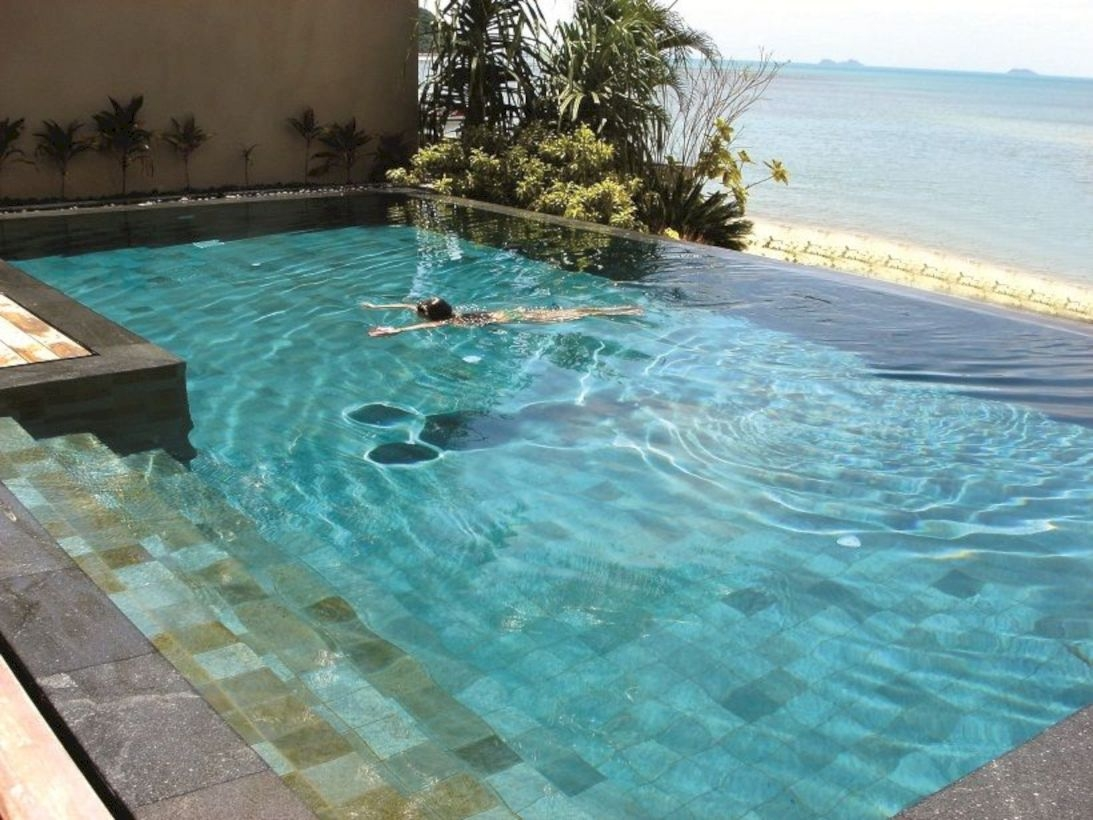 Style Swimming Pool With Natural Stone Tiles 34
