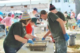 Volunteers bread oysters and clam strips to be sent to the fryers.