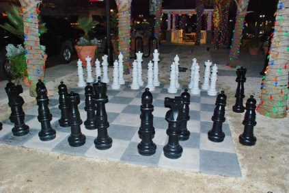 Chess set in the median of a streets in the Market Commons. The pieces can be moved to play a match.
